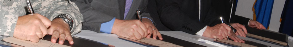 image - hands signing contract