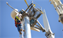A contractor makes adjustments to the wind turbine 120 feet above Buckhorn Recreation Area at Black Butte Lake, a U.S. Army Corps of Engineers Sacramento District park, near Orland, Calif. Installation of the turbine atop the pylon took place March 13, 2013. Expected to go online within 30 days, the turbine can generate 11 kilowatts of energy to help supply the needs of campers at Black Butte Lake.